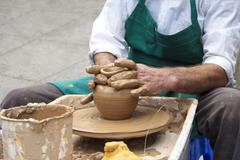 Master Potter and a Pot of Clay - stock photo
