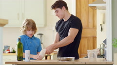 Young brother helping older brother to make Pizza for Dinner. Stock Footage