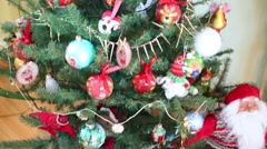 Beautiful Christmas tree with many balls and decorative dwarf Stock Footage