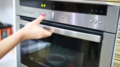Female hands open oven and take out plates of soup Stock Footage