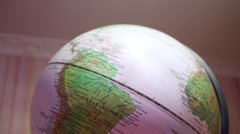 Close-up of globe with shallow depth of field (Text: South America) Stock Footage