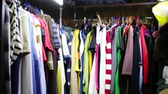 Wardrobe with dresses and clothes and sewing machine on floor Stock Footage
