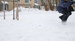 Three happy children play and fight in snow at winter day - stock footage