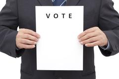 Man, Holding a Sheet with Title VOTE Stock Photos