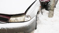 Close up of broken car after accident during snowfall at winter day Stock Footage