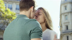 Couple enjoy a quick kiss while in the city Stock Footage