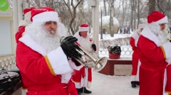 Brass Band of Santa Clauses performs in Sokolniki Park Stock Footage