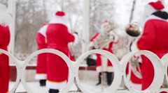 White fence and Brass Band of Santa Clauses performs out of focus Stock Footage