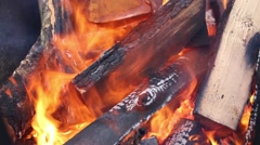 Close up of bright fire and firewood outdoor at winter Stock Footage
