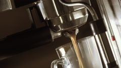 Close-Up Of Coffee Pouring From Espresso Machine Stock Footage
