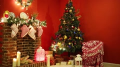 Decorated Christmas tree with presents and fireplace with socks - stock footage