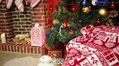 Illuminated Christmas tree with presents and fireplace with socks - stock footage
