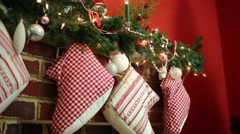 Close up of fireplace with socks and Christmas decorations Stock Footage