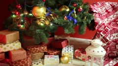 Many boxes with presents under Christmas tree in room - stock footage
