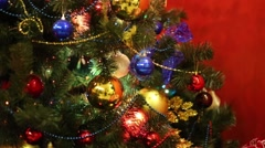 Close up of bright Christmas tree with shiny balls, garlands Stock Footage