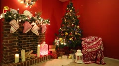 Armchair with plaid, Christmas tree with presents and fireplace Stock Footage
