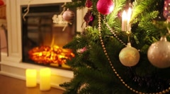 Christmas tree with balls and electric fireplace out of focus - stock footage