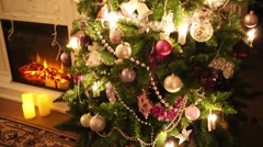 Christmas tree with balls, fireplace and tv. Text: Family Stock Footage