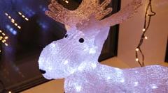 Close up of illuminated decorative deer on windowsill Stock Footage