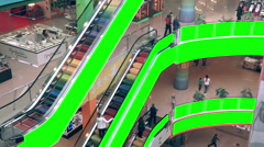 Shopping mall escalator with green screen advertising space. Huge trade center - stock footage