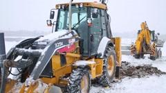Backhoe Loader John Deere 325k at winter, Moscow. Stock Footage
