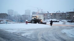 Tractor removes snow in Elk Island residential complex Stock Footage