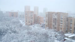 Many trees covered by snow and residential buildings at winter day Stock Footage