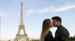 Couple enjoying each others company while visting the Eiffel tower in Paris. Stock Footage