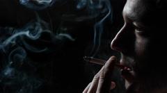 Man smoking cigarette Stock Footage