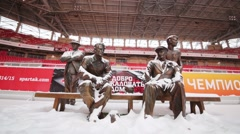 Monument to Starostin brothers in Spartak stadium during snowfall Stock Footage
