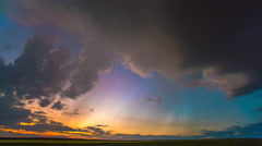 The flow of rainy cloud against the sunset. Time lapse Stock Footage