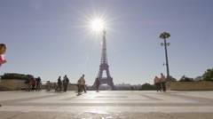 Girl running though Paris with Eiffel tower in the background. Stock Footage