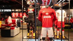 Football suits in shop in Spartak stadium, Moscow. Stock Footage