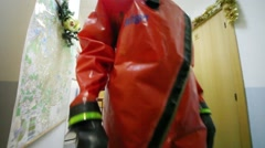 Two men show protective suits during excursion Stock Footage