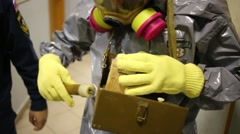 Chemical suit and equipment - Team of rescue workers Stock Footage