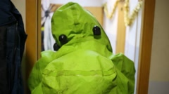 Back of man of green protective chemical suit going in hallway Stock Footage