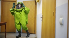 Man demonstrates protective suit - Team of rescue workers Stock Footage