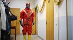 Two men show bright protective suits - Team of rescue workers Stock Footage