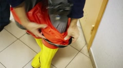Showing of protective suit - disrobing of rubber shoes Stock Footage