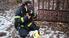 Firefighter wears mask of North Eastern Administrative District Stock Footage