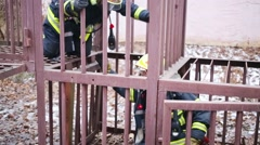 Firefighters in cage of North Eastern Administrative District Stock Footage