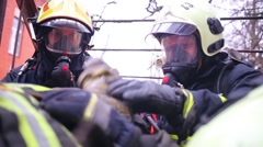 Firefighters train to rescue of injured man of North Eastern AD Stock Footage
