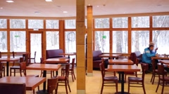 Unrecognizable people in canteen with wooden walls, tables Stock Footage