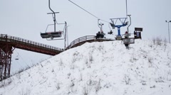 Cableway with moving people in downhill skiing sports complex Stock Footage