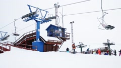 Cableway and resting people in downhill skiing sports complex Stock Footage