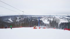 Cableway of downhill skiing sports complex at winter day Stock Footage