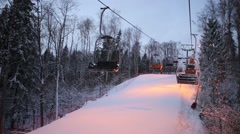 Ropeway moves above track at downhill in skiing sports complex - stock footage