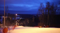 Funicular at night in downhill skiing sports complex Stock Footage
