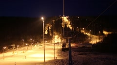 Movement on funicular above ski track at winter night Stock Footage