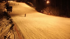 Funicular at night and track with skiers in ski resort Stock Footage
